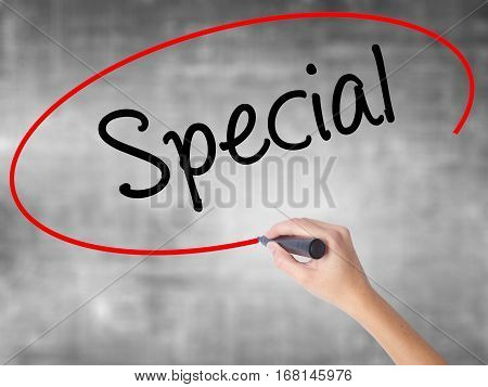 Woman Hand Writing Special With Black Marker Over Transparent Board