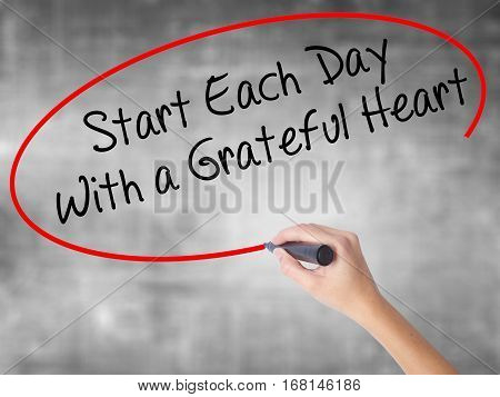 Woman Hand Writing Start Each Day With A Grateful Heart With Black Marker Over Transparent Board