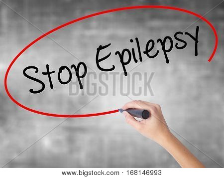 Woman Hand Writing  Stop Epilepsy With Black Marker Over Transparent Board
