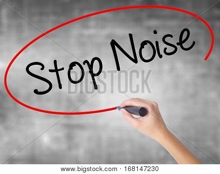 Woman Hand Writing Stop Noise   With Black Marker Over Transparent Board