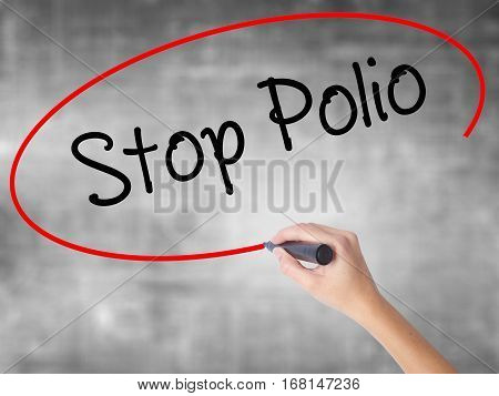 Woman Hand Writing Stop Polio With Black Marker Over Transparent Board