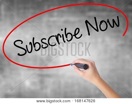 Woman Hand Writing Subscribe Now With Black Marker Over Transparent Board