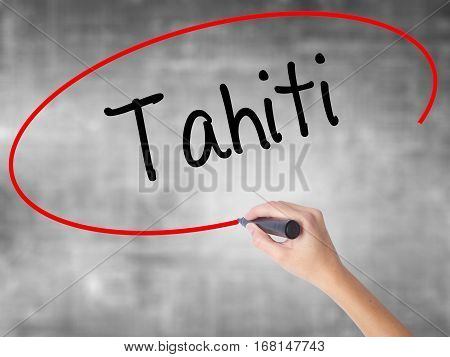 Woman Hand Writing Tahiti With Black Marker Over Transparent Board