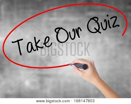 Woman Hand Writing Take Our Quiz With Black Marker Over Transparent Board