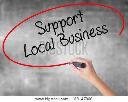 Woman Hand Writing Support Local Business With Black Marker Over Transparent Board