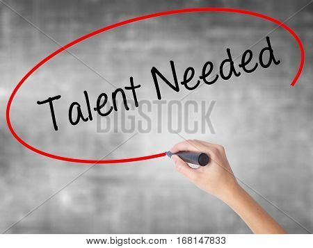 Woman Hand Writing Talent Needed With Black Marker Over Transparent Board
