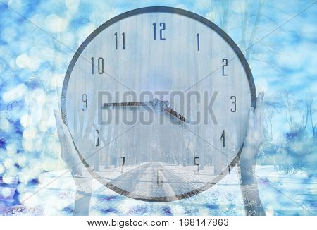Time change concept. Double exposure of female hands holding clock and winter landscape background