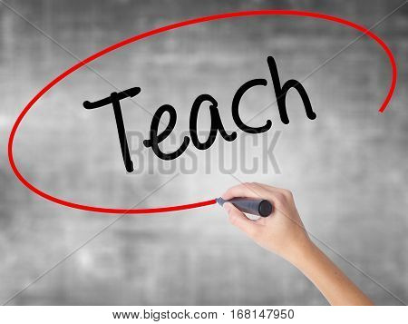 Woman Hand Writing Teach With Black Marker Over Transparent Board.