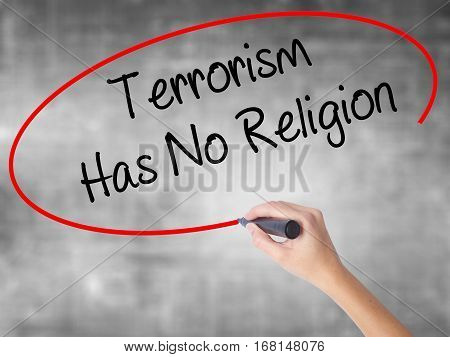 Woman Hand Writing Terrorism Has No Religion  With Black Marker Over Transparent Board