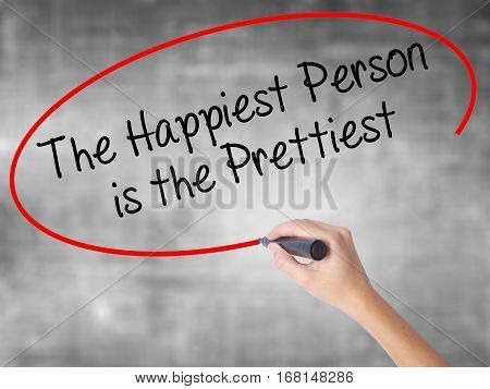 Woman Hand Writing The Happiest Person Is The Prettiest With Black Marker Over Transparent Board.