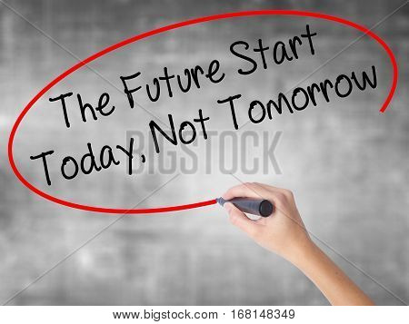 Woman Hand Writing The Future Start Today, Not Tomorrow With Black Marker Over Transparent Board.