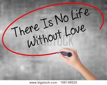 Woman Hand Writing There Is No Life Without Love With Black Marker Over Transparent Board