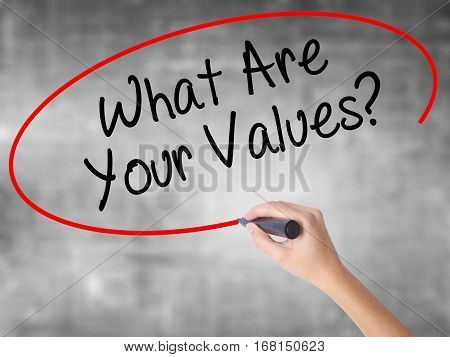 Man Hand Writing What Are Your Values? With Black Marker On Visual Screen