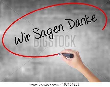 Man Hand Writing Wir Sagen Danke (we Say Thank You In German)   With Black Marker On Visual Screen