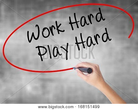 Man Hand Writing Work Hard Play Hard  With Black Marker On Visual Screen