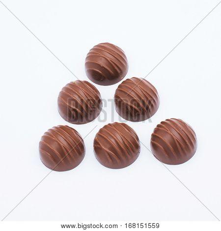 sweet chocolate pralines isolated on white background