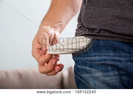 Close-up Of A Man Holding Empty Pocket With His Hand