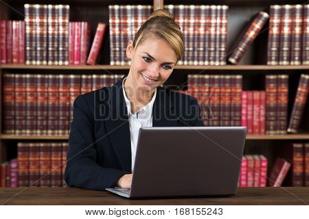 Portrait Of A Young Female Accountant Using Laptop In A Courtroom