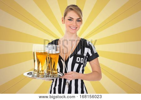 Portrait Of A Young Female Referee Holding Tray With Beer