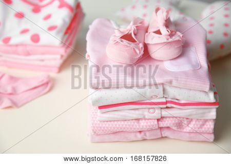 Set of baby clothes on light table