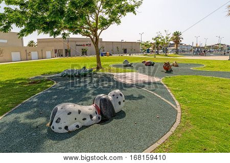TEL AVIV, ISRAEL - MAY 22, 2016: Kids playground by the long promenade Israel National Trail.