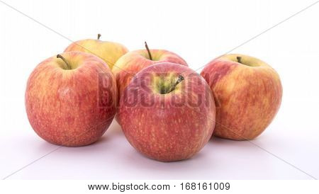 Five red apples on a white background