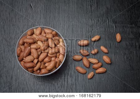 Close up of peanuts on wooden table background