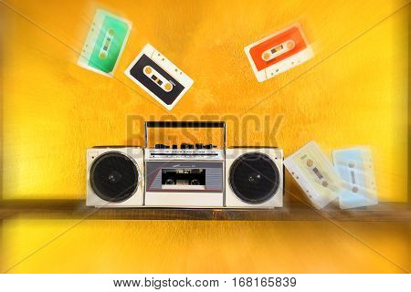 Radio tape recorder and music cassette player at starburst on golden background - Boom box portable sound system retro style - Concept of outdated vintage technology with radial zoom defocus filter
