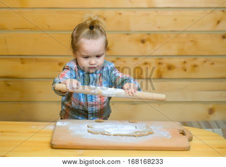 Cute Child Cooking With Dough, Flour And Wood Rolling Pin