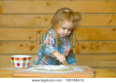 Cute Child Cooking With Dough, Flour And Bowl On Wood