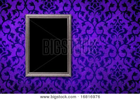 Silver frame on a vintage blue wall background
