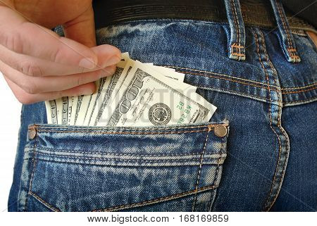 Cash, Money Is In The Pocket Of Blue Jeans
