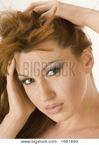 Beautiful Redheaded Woman Running Her Hands Through Her Hair