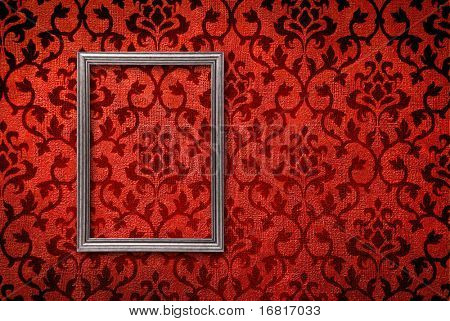 Silver frame on a vintage red wall background