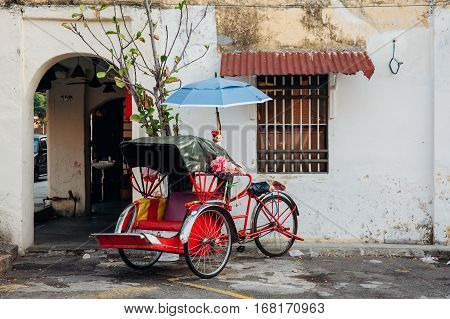 Rickshaw tricycle at the street of the old town George Town Penang Malaysia.