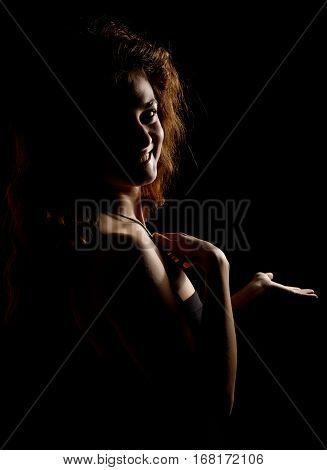 Elegant curves of female shoulders and neck, Redhead girl on a dark background.