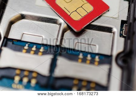 SIM card on slots in mobile phone. Close up view of the inside. Two seats for the card.