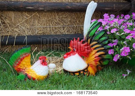 The colorful earthenware of bantam chicken in the flower garden