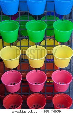 The closeup of the colorful plastic flowerpot background