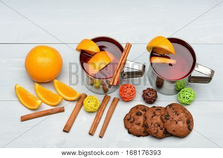 Tea Or Mulled Wine With Cinnamon, Orange, Pinecone At Christmas