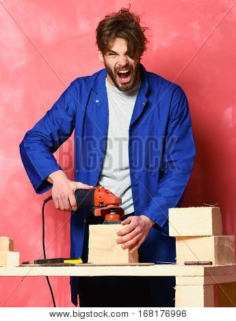 Shouting Man Holding Grinder Machine
