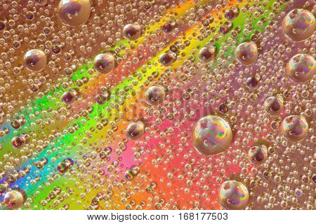 Colorful abstract formed by water droplets on the surface of a cd