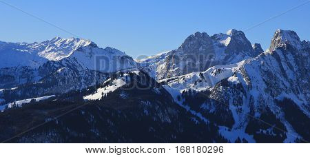 View from the Rellerli ski area Swiss Alps. Mount Gummfluh Le Rubli and others in winter.