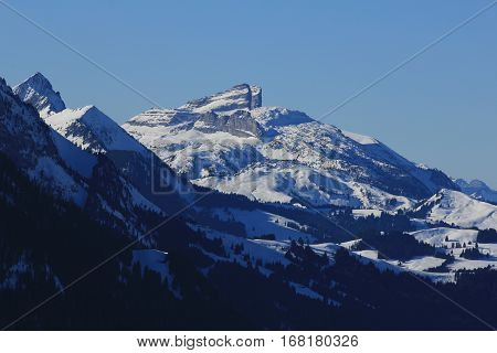 Mountains in the Swiss Alps. View from the Rellerli ski area. Snow covered mountains Tour d Ai and mount d Or.
