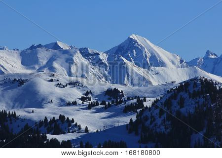 Ski slopes in the Bernese Oberland Switzerland. View from the Rellerli ski area. View of the Saanersloch ski slopes and snow covered mountains.