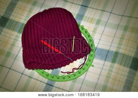Knitted woolen cap on a 36 pegs circular loom homemade crafts