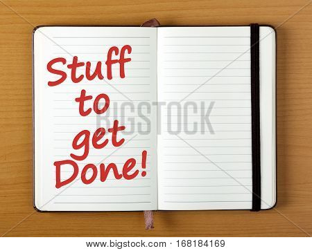 The words Stuff to get Done in red text on the page of an open notebook as a reminder to organize your day and increase productivity