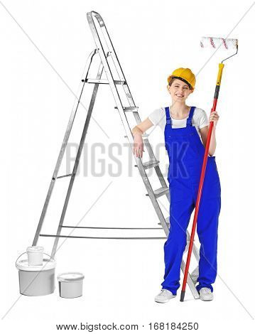 Beautiful young decorator near ladder on white background