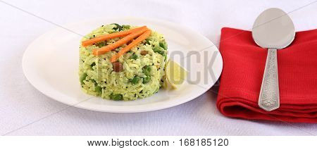 Indian vegetarian food lemon rice, a popular and traditional south Indian dish in a plate.