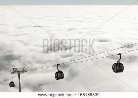 New Cable Cars Going Up And Down The Mountains At A Winter Sports Resort Area On A Cloudy Day
